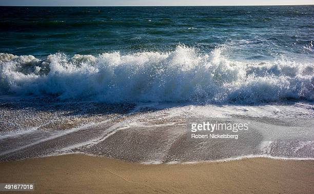 Waves break on the beach September 23 2015 on Nantucket Island in Wauwinet Massachusetts Sea levels continue to rise at the rate of 1012 inches per...