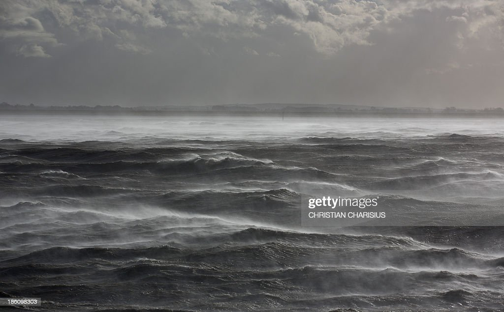 Waves break on the river Elbe flowing into the North Sea near Brunsbuettel northern Germany on October 28 2013 Autumn storms hit wide parts of Europe...