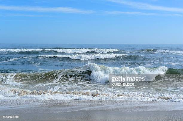 Waves break on the sand at the Assateague Island National Seashore near Berlin Maryland on November 27 2015 AFP PHOTO / KAREN BLEIER / AFP / KAREN...