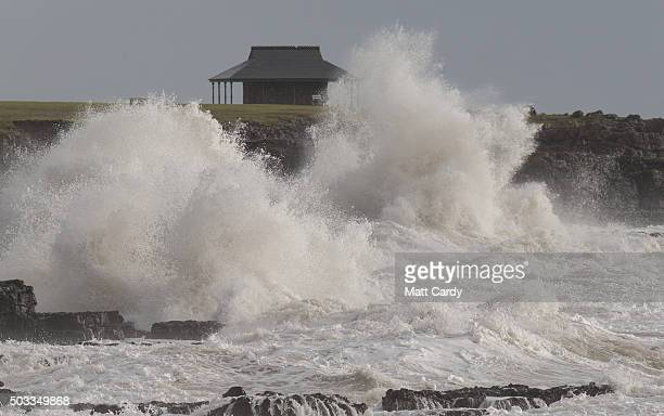 Waves break on the shore at high tide on January 4 2016 in Porthcawl Wales Stormy weather continues to bring heavy rain fall and the threat of more...