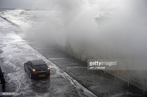 Waves break over Saltcoats Esplanade on January 3 2014 in Saltcoats Scotland Gale force winds and an expected tidal surge are set to cause wide...