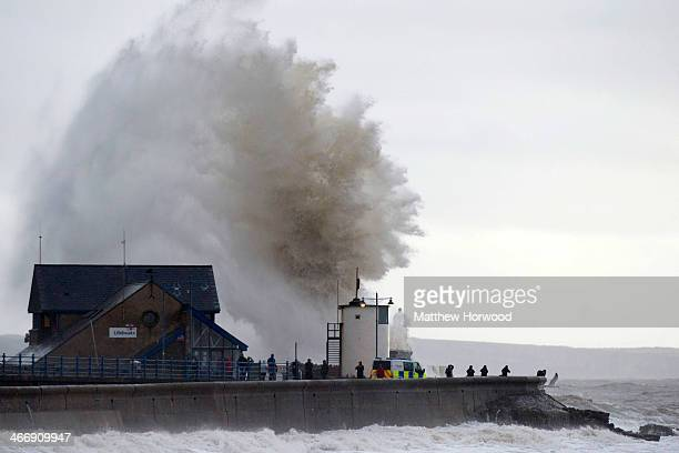 Waves break over the harbour wall at Porthcawl during a high tide on February 5 2014 in Porthcawl United Kingdom High tides combined with gale force...