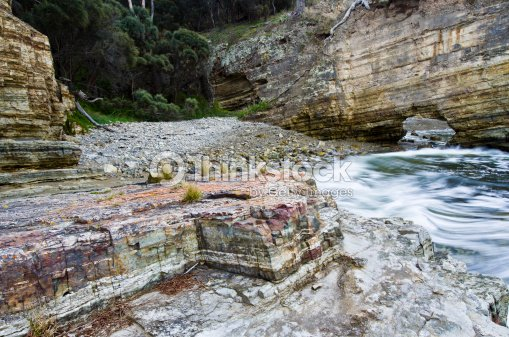 Waves breaking on layered rocks fossil cove tasmania for Landscaping rocks tasmania