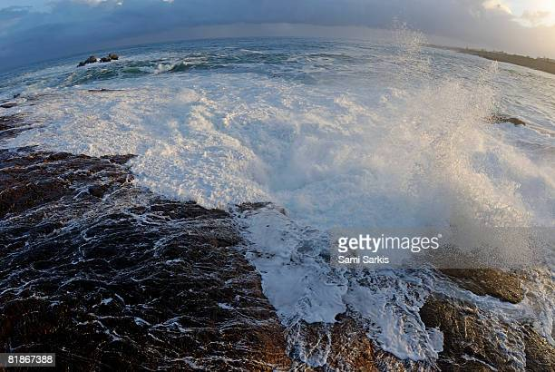 Waves breaking on rocky shore by stormy day at dusk, South Africa, South Western Cape, Hermanus,