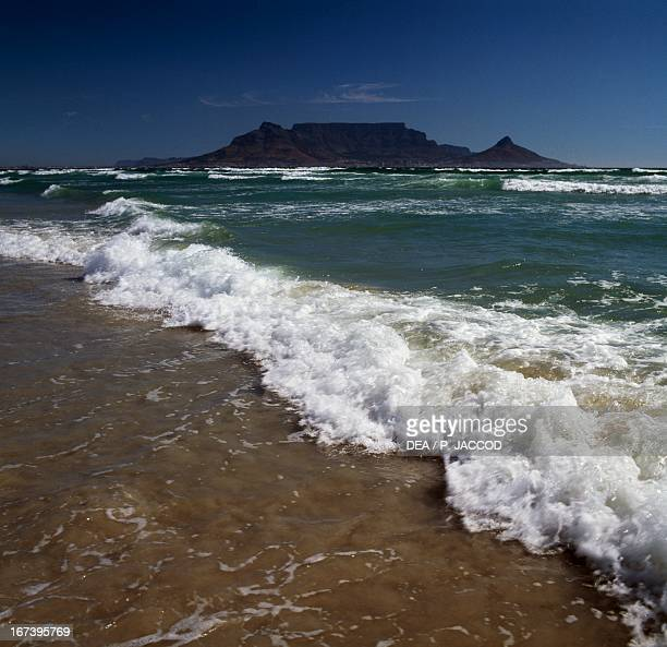 Waves breaking on the beach of Table Bay Western Cape South Africa
