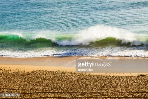 Waves breaking on the beach : Stock Photo