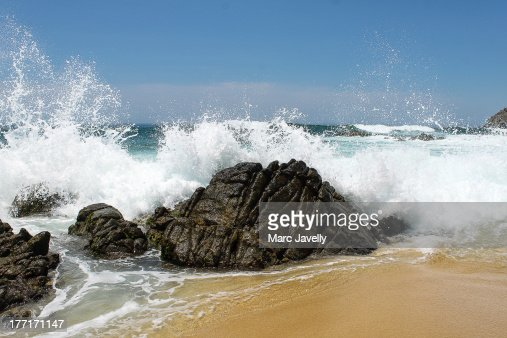 Waves breaking on the rocks