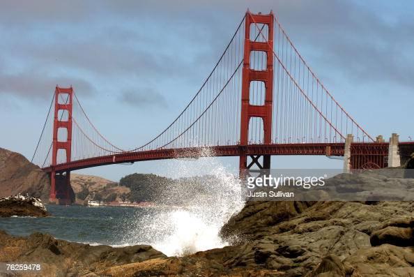 Waves crash against a rock at Baker Beach near the Golden Gate Bridge August 23 2007 in San Francisco California Golden Gate Bridge officials are...