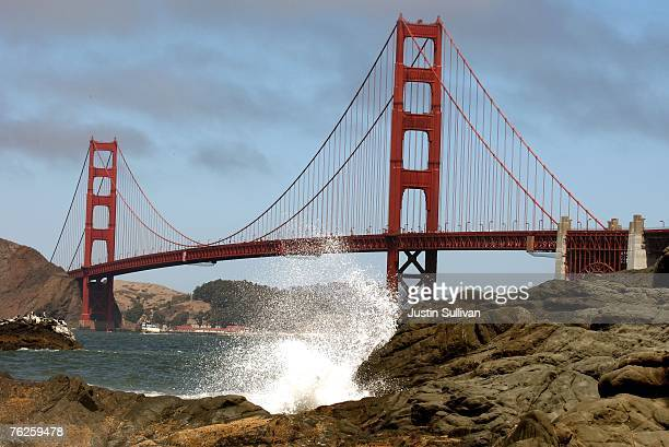 Waves crash against a rock at Baker Beach near the Golden Gate Bridge August 23 2007 in San Francisco California Golden Gate Bridge officials are...