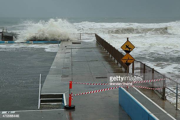 Waves crash against Queencliff rock pool on April 22 2015 in Sydney Australia Three people have died and more than 200000 are still without power as...