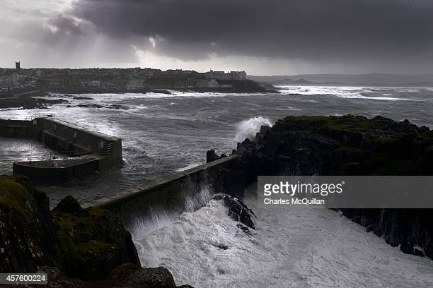 Waves crash against the harbour wall at Portstewart on October 21 2014 in County Antrim Northern Ireland The Met Office has issued a yellow warning...