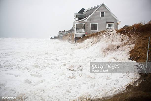 Waves crash against the home at 41 Annapolis Way which was knocked off its foundation as a heavy winter storm caused damage along the coast...