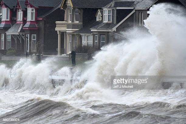 Waves crash against the promenade wall on December 10 2014 in Prestwick Scotland High winds and large waves hit the North West Coast of the UK and...