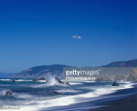Waves crash against the rocks in Mendocino County California : Stock Photo