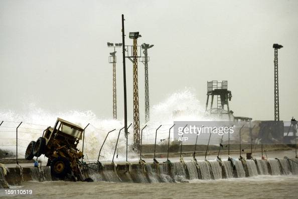 Waves crash into the shore of the southern Lebanese city of Sidon on January 8 2013 Stormy weather including high winds and heavy rainfall lashed the...
