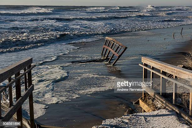 Waves crash near a pier after a blizzard hit the region on January 24 2016 in Stone Harbor New Jersey A major snowstorm hit the East Coast over...