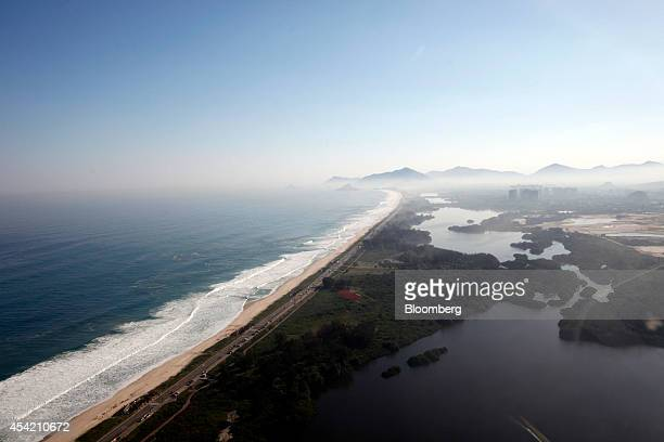 Waves crash on the beach in the Barra da Tijuca neighborhood where the 2016 Summer Olympics will be held in this aerial photo taken in Rio de Janeiro...