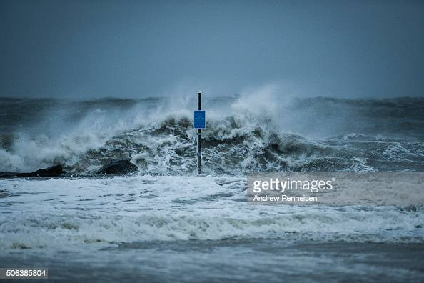 Waves crash on the beach on January 23 2016 in Cape May New Jersey A major snowstorm is upon the East Coast this weekend with some areas expected to...