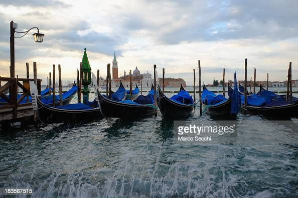 Waves crash on the Saint Mark's banks during the first 'Acqua Alta' of the season on on October 7 2013 in Venice Italy The high tide or acqua alta as...