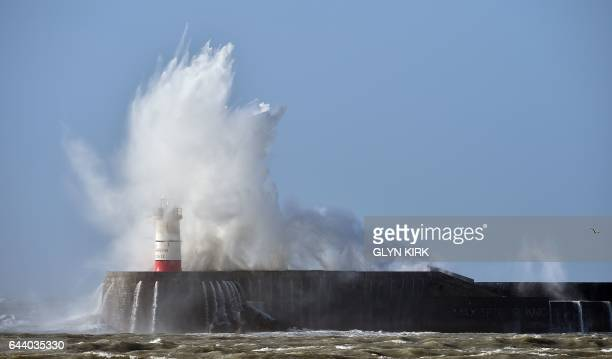 Waves crash over Newhaven Lighthouse on the south coast of England on February 23 2017 as Storm Doris hits the country / AFP / GLYN KIRK