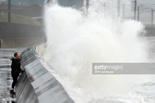 Waves crash over the breakwater as the remnants of Hurricane Ophelia hit Saltcoats on the west coast of Scotland on the morning of 17th October 2017...