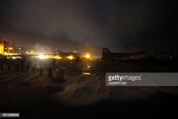 Waves crash over the old harbor of the historical Lebanese city of Byblos north of Beirut on January 6 2015 Lebanese authorities have suspended air...