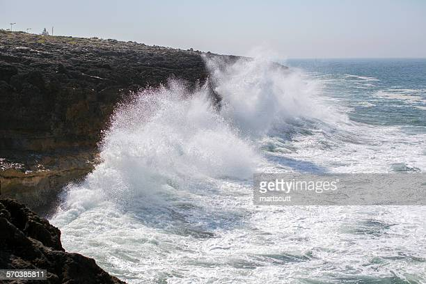 'Waves crashing against rocks on the lisbon coastline, Portugal'