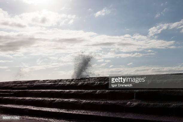 Waves crashing against sea wall, Santa Cruz de Tenerife, Canary Islands, Spain, Europe