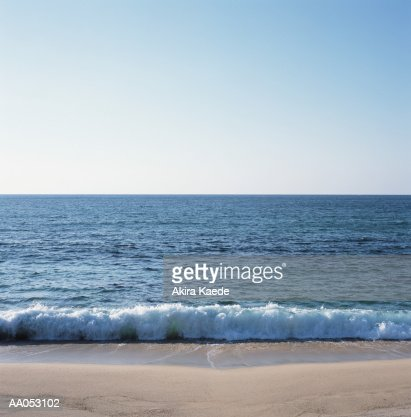 Waves crashing on beach : Stock Photo