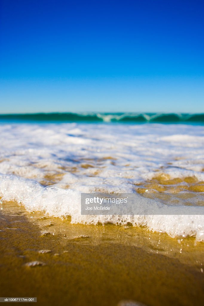 Waves crashing on beach : Stock Photo