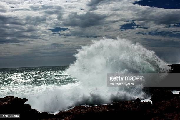 Waves Crashing On Rocks At Beach