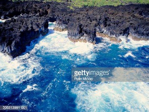 Waves crashing on rocky coastline, aerial view : Stock Photo