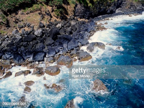 Waves crashing on rocky coastline, aerial view : Stock Photo
