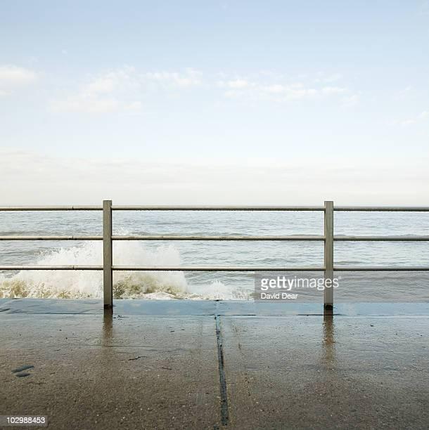 Waves crashing on seafront