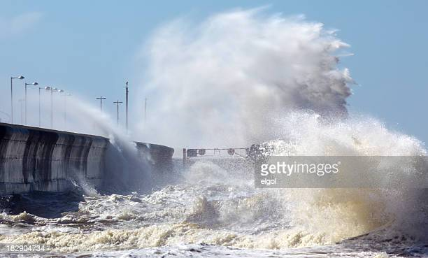 Waves crashing onto seafront in stormy weather