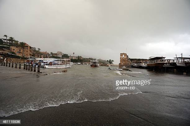 Waves flood the harbour of the historical Lebanese city of Byblos north of the capital Beirut on January 7 2015 The fierce winter storm lashing the...