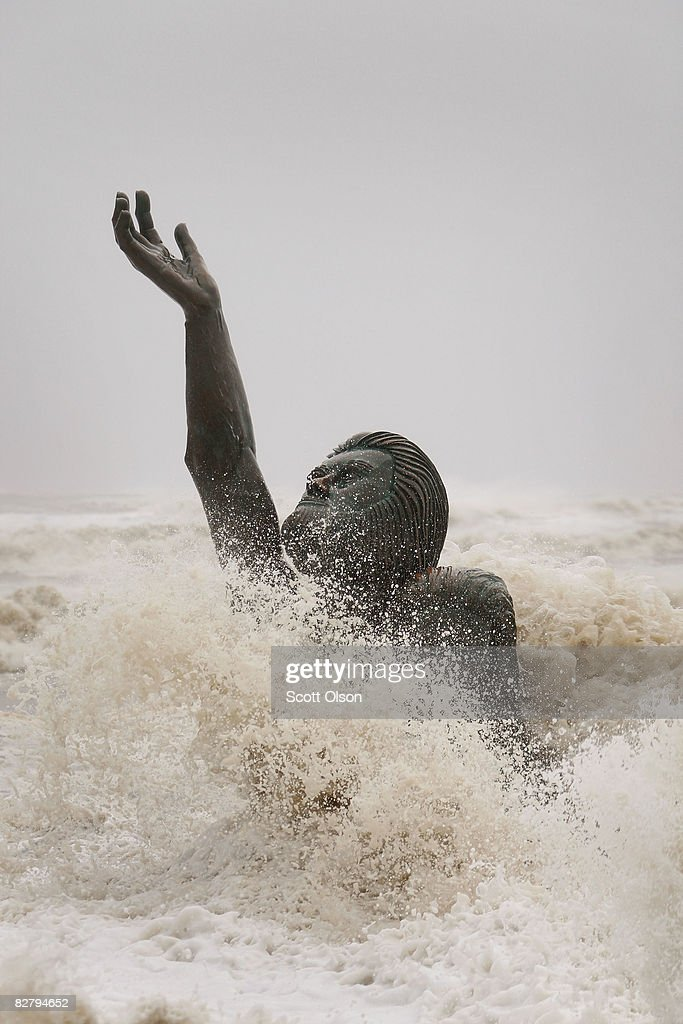 Waves from Hurricane Ike engulf a sculpture dedicated to the 6000 who died on Galveston Island from a 1900 hurricane September 12 2008 in Galveston...