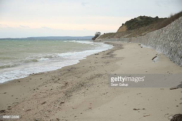 Waves from the Aegean Sea lap onto the shores of Anzac cove on April 9 2015 near Eceabat Turkey Allied and Turkish representatives as well as family...
