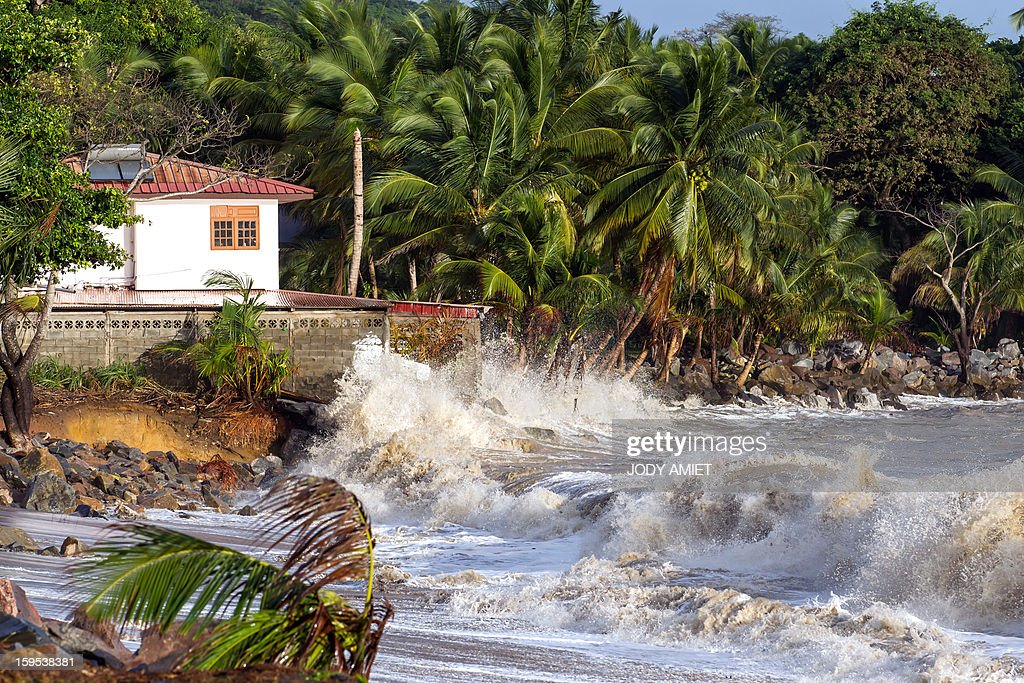 Waves hit the coast near Cayenne on January 15, 2013. The coast of Guyana switched to 'red alert' today as several houses of Rémire-Montjoly (10 km from Cayenne) have been 'damaged' due to high tides, the prefecture of Guyana said in a statement.