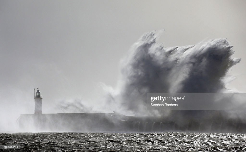 Waves hit the sea wall and lighthouse at Newhaven harbour on February 8, 2016 in Newhaven, East Sussex. Storm Imogen is the ninth named storm to hit the UK this season. This year's storms are being named in an effort by the Met Office and Met Eireann to increase public awareness and safety. They were named by public ballot and there are no names for the letters Q, U, X, Y and Z.