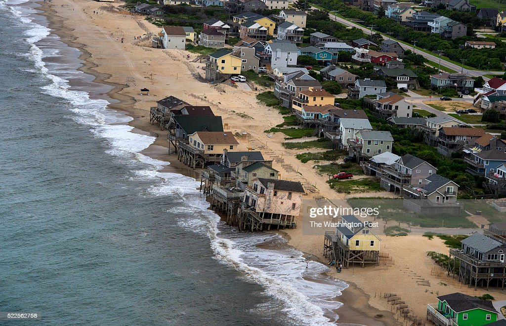 Waves lap around the stilts of a row of condemned homes in Nags Head North Carolina on Thursday June 12 2014