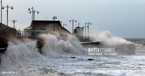 Waves lash the seafront at Porthcawl Wales before high tide