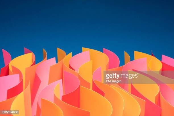 Waves of sheets of paper that mimic fire