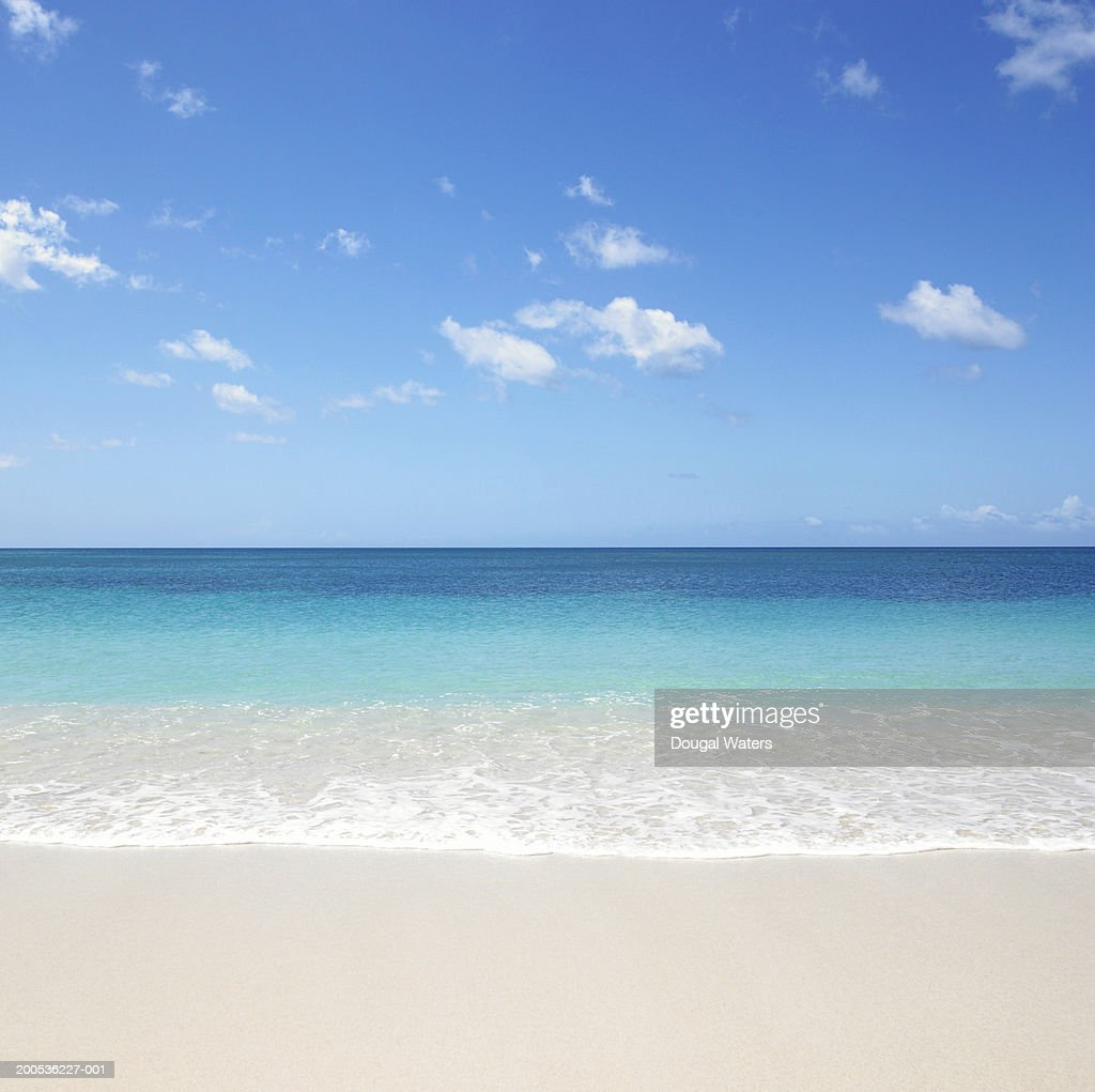 Waves on beach : Stock Photo