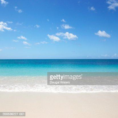 Waves on beach : Bildbanksbilder