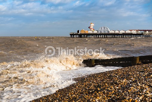 waves on the beach by herne bay pier kent uk stock photo. Black Bedroom Furniture Sets. Home Design Ideas