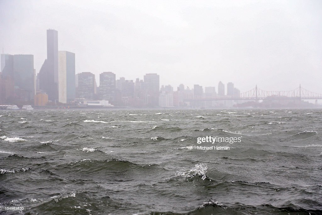 Waves pick up on the East River ahead of Hurricane Sandy on eastside of Manhattan on October 29 2012 in New York City Sandy which has already claimed...