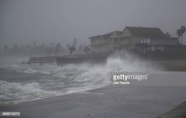 Waves pound the shore from approaching Hurricane Harvey on August 25 2017 in Corpus Christi Texas Hurricane Harvey has intensified into a hurricane...