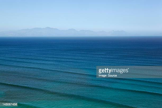 Waves rippling on calm ocean waters