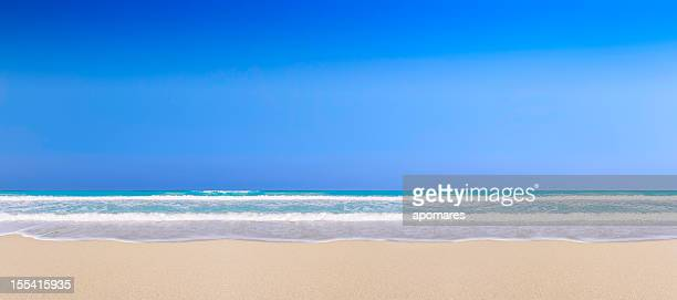 Waves, sand and sky in a tropical beach background